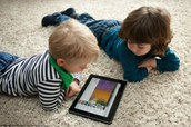 Toddlers engaged in iPad