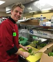 Chef Adam Klosterman slicing up veggies for the jambalaya