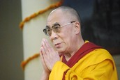 14th Dalai Lama Praying
