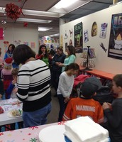 Students, teachers, and parents working on Star Wars crafts.