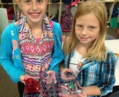 Karys and Madison created a complete circuit using snap circuits.