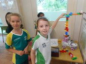 3AGr children building and testing out their Rube Goldberg machine.