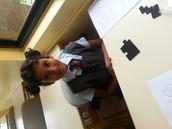 Student doing Pentaminoes Puzzle