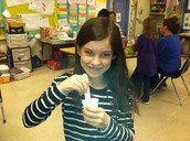 Paige mixing paint for her ecosystem project