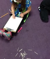 Students record findings after using toothpicks to measure.