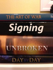 Create a spine poem with 3 books. Snap a picture to share it!