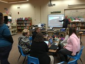 The AMAZING Tech Team helps teachers learn about new device!