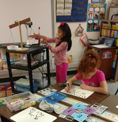 Bianka working to balance her equation.