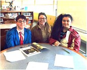 Miss Slade, Angelea and Nick take a break from library class to smile for the camera