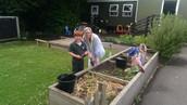 Henry Yeulett and Mrs Griffiths tending the garden.