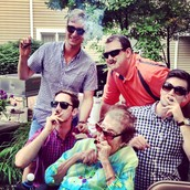 Grandma teaching the boys how to smoke cigars!