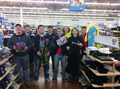 Football players shop for family in need