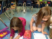 Willa and Lillie working together on writing.