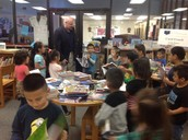 Dr. Wallis drops in to see what the noise is in the library!