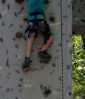 Luke is scaling the wall!