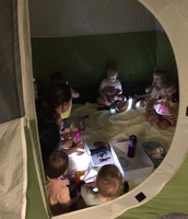 Bible story inside the tent with Ms. Lisa