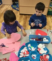 Tess and Cameron making Valentines