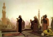 A imam leading a praying ritual.