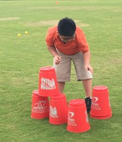 Aidan stacking cups in the relay.