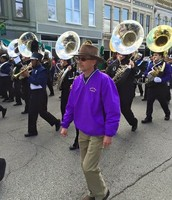 Mr. Briley marching alongside the Purple Band in the Veteran's Day Parade.