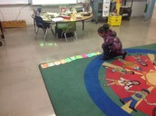 A math curriculum goal embedded in Jeff Joyner's music class. A K student working on a pattern based on the music notes.