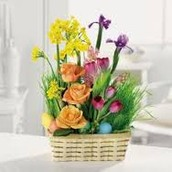 Grass filled basket with accent flowers
