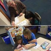 Mrs. Vetor working with Quita on Fluency!