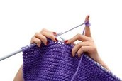 Knitting with thin needles and wool.