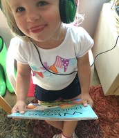 Isabelle listening to audio books