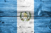 A guatemalan flag painted on wood.