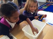 Kloey and Maya Making Sink or Float Observations