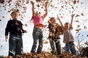 Kids throwing leaves