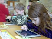Picture of students focusing in on their iPads during class