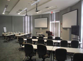 A fully equipped conference room that seats up to 24