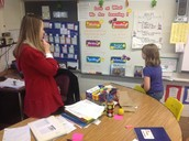 Third grader in Shelly Breitbeil's class reviews the Learning Targets for the day with the class. Targets are referenced throughout the day.