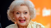 "Betty White as ""Mrs. Cora"""