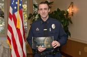 Officer McFarland getting his award.