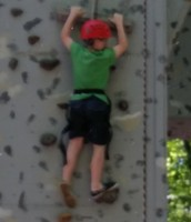 Logan is scaling the wall!