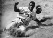 Jackie Robinson sliding into base