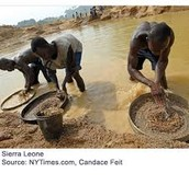 Kids sift through sand for diamonds and gold
