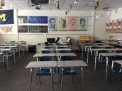 Symmetrical desks in history room.