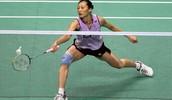 Female Playing Badminton