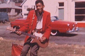 Jimi With His First Guitar