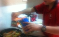 Putting Vegeta spice on the chicken and the vegetables