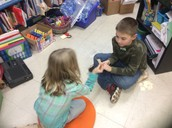 Working with their turn and talk partner with a focus on learning multiplication facts
