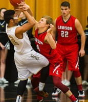 Logan Weber ties up a  Cameron Dragon player in a win against Cameron on 12/15