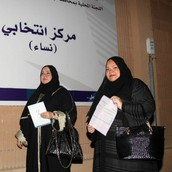 Two Saudi Arabian Women Adding in Their Ballots