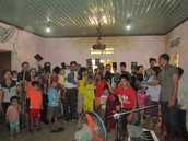 A local church group receiving doctrinal books from Khoa.