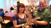 Ms. Smith holds an alligator @ Grad Nite Busch Gardens