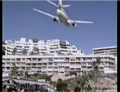 Airline Jet knocks Antenna's off Skyscraper Rooftop